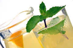 Lemon juice in a jug and a glass Royalty Free Stock Photos