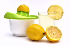 lemon juice with organic lemons on the side Stock Photos