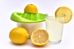 Lemon juice with organic lemons on the side Stock Image