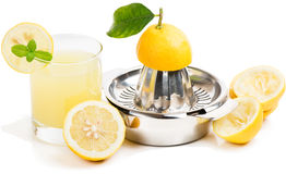 Lemon juice, squeezer and fruits Royalty Free Stock Images