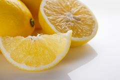 Lemon and juice on a white background.  Royalty Free Stock Photos
