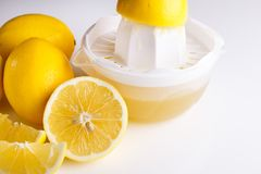 Lemon and juice on a white background.  Stock Images