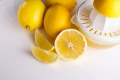 Lemon and juice on a white background.  Stock Photo