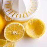 Lemon and juice on a white background.  Royalty Free Stock Photo