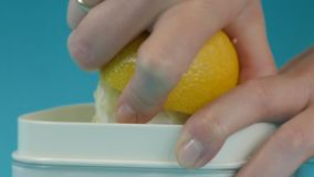 Lemon juicing and squeezing close up stock footage