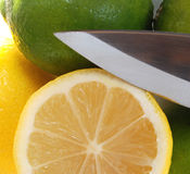 Lemon and knife 21. Cut lemon and limes and blade of knife Royalty Free Stock Photography