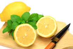 Lemon and knife Stock Images