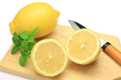 Lemon and knife Stock Image