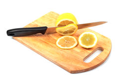 Lemon and knife on hardboard Royalty Free Stock Images