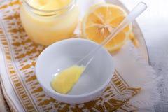 Lemon kurd with a spoon Royalty Free Stock Image