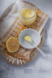 Lemon kurd with a spoon. Served on a table Stock Photography