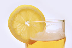 Lemon lager. Slice of fresh lemon and beer Royalty Free Stock Photos
