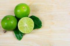 Lemon and leaf on wood background Stock Photos