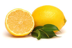 Lemon with leaves. On the white background Stock Images