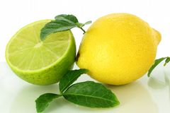 Lemon with leaves Stock Photo