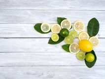 Lemon with leaves on white wooden stock image