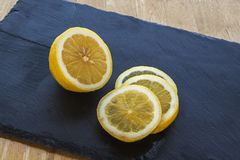 Lemon and lemon slices, juicy and ripe. Stock Photography