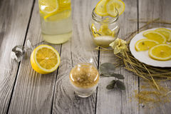 Lemon, lemonade , cane sugar on wooden background. Beautiful composition with lemon, lemonade , cane sugar on wooden background Royalty Free Stock Photos