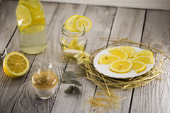 Lemon, lemonade , cane sugar on wooden background. Beautiful composition with lemon, lemonade , cane sugar on wooden background Royalty Free Stock Images
