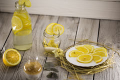 Lemon, lemonade , cane sugar on wooden background. Beautiful composition with lemon, lemonade , cane sugar on wooden background Stock Photos