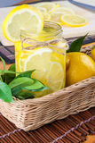 Lemon. Ade with some fresh uncut yellow  in wooden kitchen table Stock Image