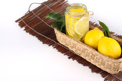 Lemon. Ade with some uncut  inside a basket ready copy space Stock Photos