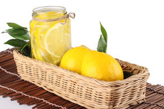 Lemon. Ade with some uncut  inside a basket ready copy space Stock Photo