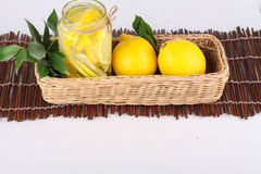 Lemon. Ade with some uncut  inside a basket ready copy space Royalty Free Stock Image