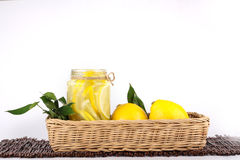 Lemon. Ade with some uncut  inside a basket ready copy space Royalty Free Stock Images