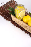 Lemon. Ade with some uncut  inside a basket ready copy space Royalty Free Stock Photography