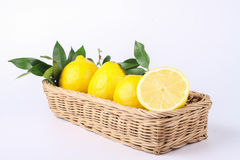 Lemon. S in basket isolated on white background Royalty Free Stock Photography
