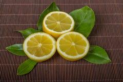 Lemon. Lemons. Fresh ripe lemons on a dark background of bamboo. Top view Royalty Free Stock Images