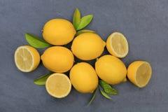 Lemon lemons fruits slate top view Royalty Free Stock Photos
