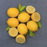 Lemon lemons fruits square slate top view Stock Photos