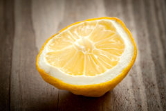 The lemon lies on  table Stock Photography