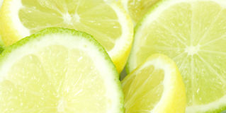 Lemon and lime. Close-up of lemon and lime halves Stock Images