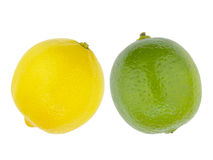 Lemon and lime. Closeup of lemon and lime citrus fruits over white royalty free stock images