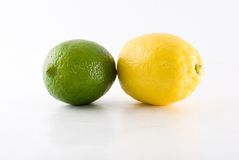 Lemon and lime. Side by side of lemon and lime isolated on white background royalty free stock photos