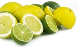 Lemon and lime. On white stock photos