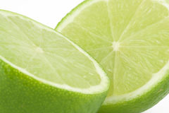 Lemon lime. Fresh and green lemon lime halves on the white background royalty free stock photo