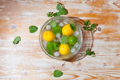 Lemon and lime in a bowl Stock Photos