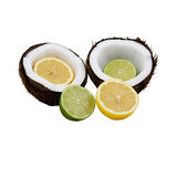 Lemon lime coconut. Lemon and lime cut in half placed in front of and inside a coconut that is split open  isolated on a white background Royalty Free Stock Photography