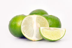 Lemon or lime fruit with half cross section and partial section Royalty Free Stock Photos