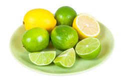 Lemon and lime fruits on a plate Royalty Free Stock Photography