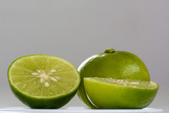 Lemon. Lime grown year-round in tropical climates and are usually smaller and less sour than lemons. As compared to lemons, limes contain less vitamin C. Limes Royalty Free Stock Images