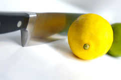 Lemon and lime with knife. Knife and lemon royalty free stock photos