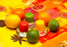 Lemon, lime and mandarin on table with candles. Stock Photography