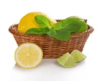 Lemon, lime and mint in basket Royalty Free Stock Photos