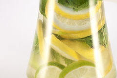 Lemon, lime and mint, inside glas. Isolated on white background Stock Photography