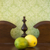 Lemon and lime on old sideboard Stock Photos